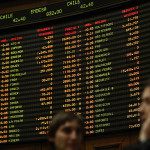 Bolsas latinoamericanas optan por cierre en rojo con Wall Street mixto