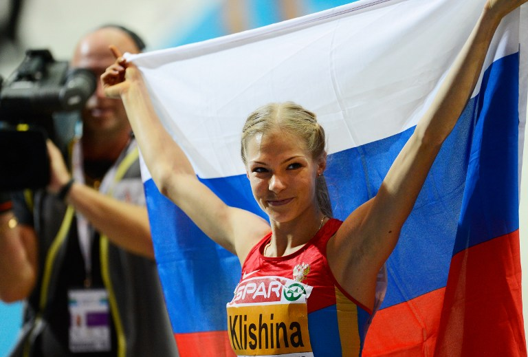(FILES) This file photo taken on March 02, 2013 shows Russia's Darya Klishina celebrating after she won the women's Long Jump final at the European Indoor athletics Championships in Gothenburg, Sweden, on March 2, 2013. The International Olympic Committee on July 24, 2016, decided not hit Russia with a blanket for the Rio Games over state-run doping, but said each sports federation needed to establish an athlete's individual eligibility. The IAAF banned all of the Russian track and field team over allegations of state-sponsored doping but said athletes who prove they were not tainted by their country's corrupt system could be cleared. The IAAF has only permitted one Russian team member to compete in Rio as a neutral: US-based long jumper Darya Klishina. / AFP PHOTO / JONATHAN NACKSTRAND