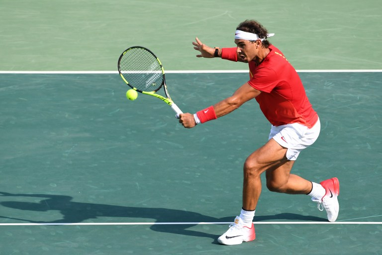 Spain's Rafael Nadal returns the ball to Italy's Andreas Seppi during their men's second round singles tennis match at the Olympic Tennis Centre of the Rio 2016 Olympic Games in Rio de Janeiro on August 9, 2016. / AFP PHOTO / Luis Acosta