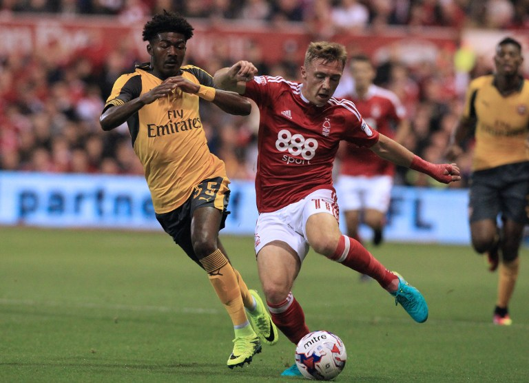 Arsenal's English midfielder Ainsley Maitland-Niles (L) vies with Nottingham Forest's English midfielder Ben Osborn during the English League Cup third round football match between Nottingham Forest and Arsenal at The City Ground in Nottingham, central England on September 20, 2016. / AFP PHOTO / Lindsey PARNABY / RESTRICTED TO EDITORIAL USE. No use with unauthorized audio, video, data, fixture lists, club/league logos or 'live' services. Online in-match use limited to 75 images, no video emulation. No use in betting, games or single club/league/player publications.  /