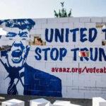 """Alemania: Activistas derriban el """"muro del odio"""" de Donald Trump"""