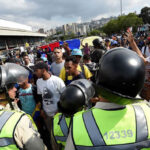 Venezuela: Un policía muerto y dos heridos durante marchas deprotesta