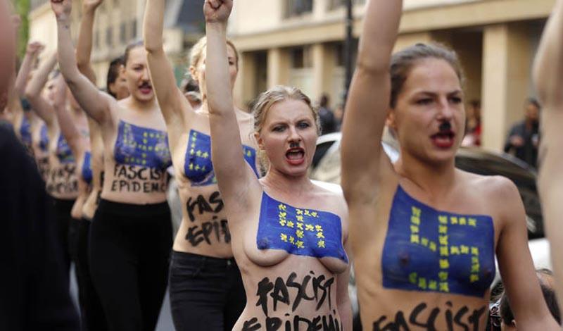 Télam-Paris,22/04/2014- Activistas del movimiento de mujeres de Ucrania protestan en Topless y levantan sus puños para  perturbar una conferencia de prensa de extrema derecha del partido Frente Nacional  francés (FN), que marca el inicio de la campaña electoral del FN para las elecciones del Parlamento Europeo, que tendrán lugar del 22 mayo al 25 mayo 2014.  Foto: AFP / Thomas Samson/Télam/jc.
